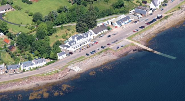 An aerial view of the Lochcarron Hotel showing the loch just across the road from the hotel.