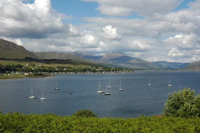 A panoramic view of Loch Carron and Lochcarron village as seen from the top of Slumbay Island