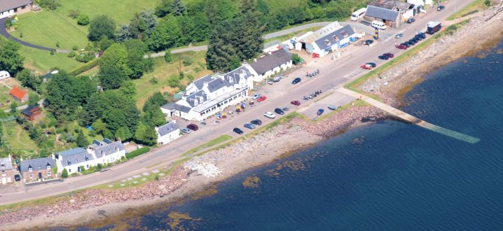 An aerial view of the Lochcarron Hotel. The hotel stands just across the road from the water's edge and there are superb sea and mountain views.